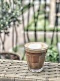 在玻璃的热奶咖啡 库存图片