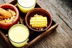 在玻璃的玉米牛奶 图库摄影