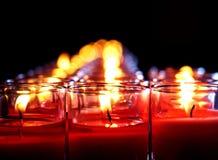 在玻璃的红色蜡烛烧伤 免版税图库摄影