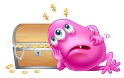 在珍宝箱子旁边的一个桃红色童帽妖怪 库存照片