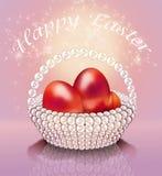 在珍珠篮子的复活节彩蛋 库存照片