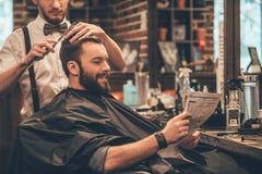 在理发店的了不起的时间 库存照片