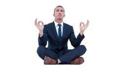 在瑜伽姿势的禅宗商人 库存照片