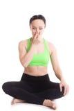 在瑜伽容易的姿势的Nadi shodhan pranayama 库存图片
