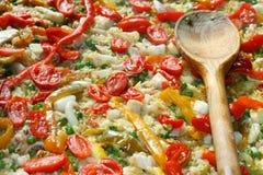 在瓦伦西亚语肉菜饭的匙子在西班牙餐馆 免版税库存照片
