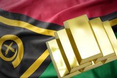 在瓦努阿图旗子的光亮的金黄金块 免版税库存照片