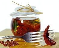 在瓶子的各式各样的蕃茄 免版税库存图片