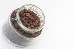 在瓶子的咖啡豆 免版税库存图片