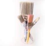 在瓶子的四把使用的装饰的油漆刷 免版税库存图片