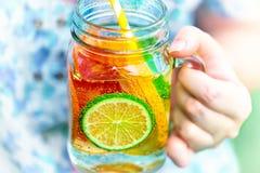 在瓶子的果子柠檬水 图库摄影