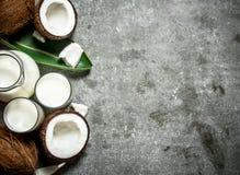 在瓶子的椰奶 免版税库存照片