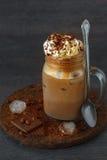 在瓶子的被冰的咖啡 库存照片