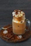 在瓶子的被冰的咖啡 库存图片