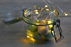 在瓶子玻璃的蜡樱桃与LED光 免版税库存照片