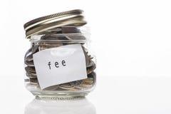 在瓶的硬币 免版税库存图片