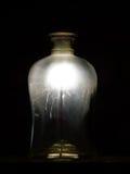 在瓶的闪烁发光物光 免版税库存照片