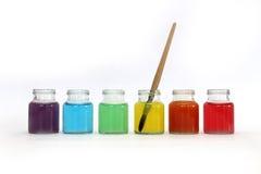 在瓶的颜色水 免版税库存图片