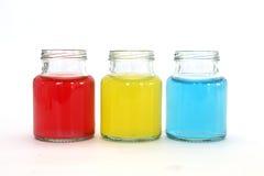 在瓶的颜色水 图库摄影