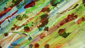 在生动的颜色的绿色红色蓝色黄色泥泞的蜡状的生动的背景 库存照片