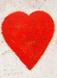 在生锈的背景的红色重点 库存图片