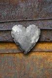 在生锈的背景的金属重点 库存照片