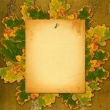 在生锈的金属墙壁上的老纸目录有明亮的秋叶的 免版税库存图片