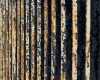 在生锈的金属篱芭,透视图的剥落的油漆 图库摄影