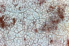 在生锈的铁背景纹理的破裂的油漆 免版税库存照片