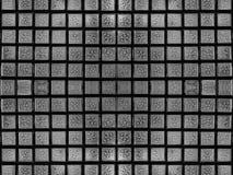 在用玻璃做的正方形砖的下落 库存照片