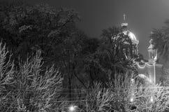 在用雪盖的树中的一个教会 库存图片