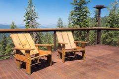 在甲板山景的椅子 图库摄影