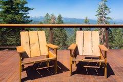 在甲板山景的椅子 库存图片