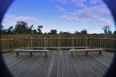 在甲板的长木凳 免版税图库摄影