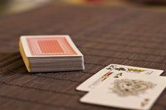 在甲板附近的两张卡片在表上 库存照片