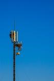 在电信天线的鹳巢 免版税库存图片
