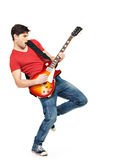 在电吉他的新吉他弹奏者作用 免版税库存图片