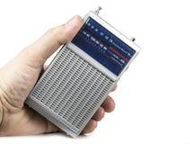 在电池的老和小晶体管收音机在白色 免版税图库摄影