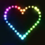 在电灯泡做的彩虹颜色的霓虹心脏 图库摄影