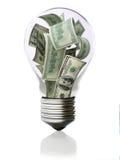 在电灯泡概念的货币 库存图片