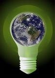 在电灯泡的地球 库存照片