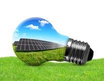 在电灯泡的太阳电池板 免版税库存图片
