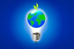 在电灯泡的抽象地球 免版税库存图片