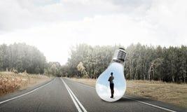 在电灯泡里面的女实业家 免版税库存图片