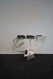 在电线的被暴露的导线在墙壁 库存照片