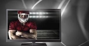 在电视上的美国橄榄球运动员 免版税图库摄影