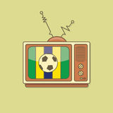 在电视的平的风格化足球 巴西旗子颜色 图库摄影