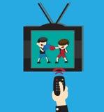 在电视的手表拳击 免版税库存照片