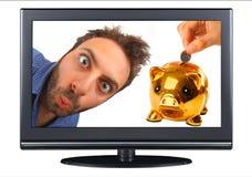 在电视的Wow表示与存钱罐 免版税库存照片