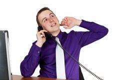 在电话的生意人 免版税图库摄影