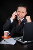 在电话的生意人 库存照片